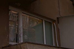 Счупените прозорци на фаталния апартамент