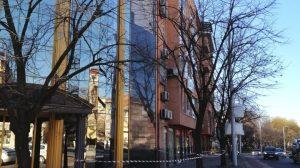 Изпадала е част от облицовката на сградата.